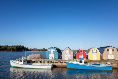 Lobster barns, lobster pots and the fishing boats of New London, Prince Edward Island, Canada