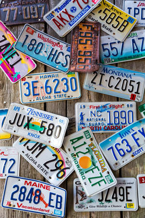 Bar Harbor, Maine, USA - August 28 2014: Old car license plates on a wall in Bar Harbor. In the United States, each jurisdiction has a unique design, usually displaying a symbol of the issuing state. Editorial