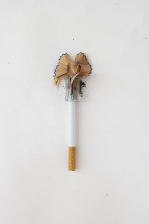 Cutting a cigarette with a pencil sharpener Stock fotó