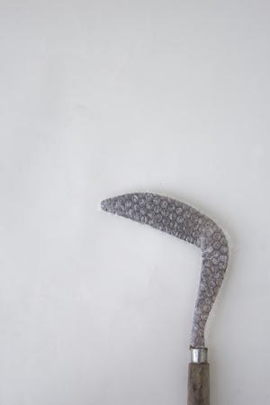 Sickle wrapped on plastic bubblewarp 版權商用圖片