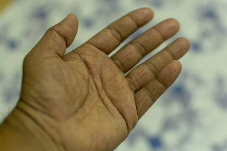 an indian man hand with blurry background