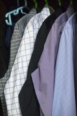 mix of men's shirts hanged in wardrobe 免版税图像