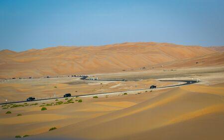 a beautiful view of reoad crossing through clean sand dune from Liwa desert Abu Dhabi