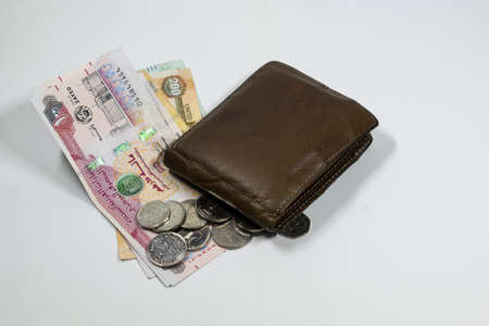a wallet and UAE dirhams and coins with white background Stock fotó