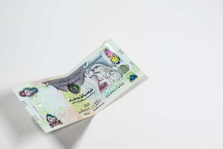 A close up view of United Arab Emirates currency, with white background, UAE Dirhams Stock fotó