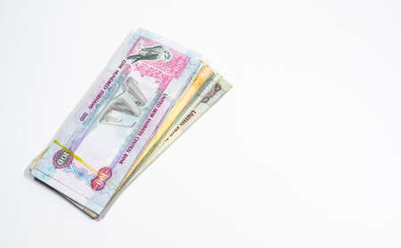 A close up view of United Arab Emirates currency, with white background, UAE Dirhams