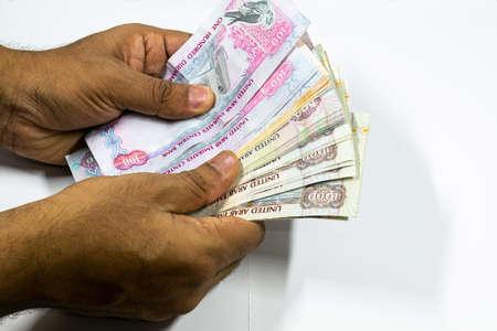 a man counting UAE currency in white background, UAE DIrhams, Stock fotó