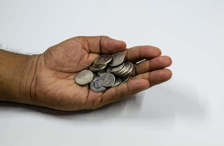 A man hand with full of UAE coins with white background, fils,