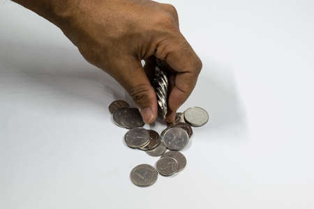 A man hand taking UAE currency coins with white background