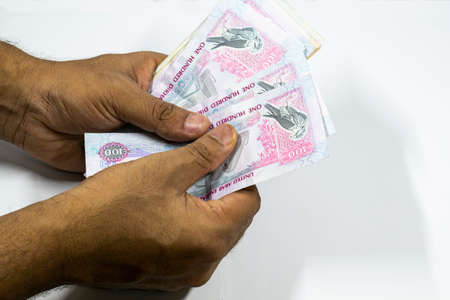 a man counting UAE currency in white background, UAE DIrhams,