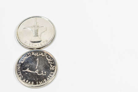 a close up view of United Arab Emirates coin with white background, fils, UAE currency, UAE coins, fils