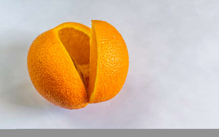 A sweet Orange sliced in white backgound,  Selective focus, Selective focus on subject, background blur