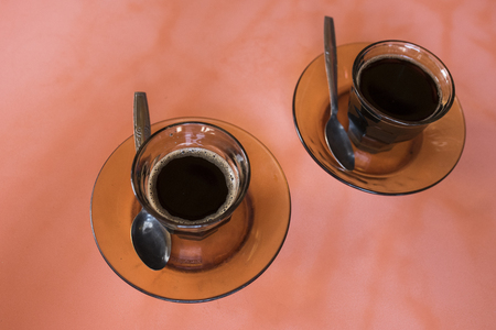 two coffees in a glass
