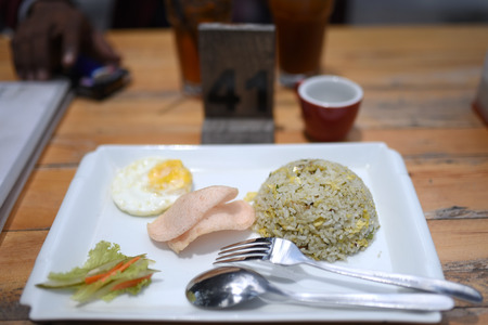 fried rice with round eggs