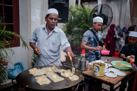Banda Aceh, Indonesia - March 8, 2020: Omelette / Martabak Egg seller is cooking Martabak at an event in the city of Banda Aceh. Editorial