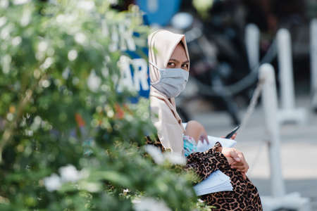 A woman wearing a mask to prevent transmission of the COVID-19 outbreak while visiting the Banda Aceh City government office, Aceh province, Indonesia. Tuesday, March 21, 2020. Editorial