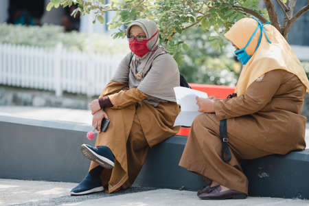 Office visitors wore masks and sat far apart to prevent transmission of the COVID-19 outbreak while visiting the Banda Aceh City government office, Aceh province, Indonesia. Tuesday, March 21, 2020. Editorial