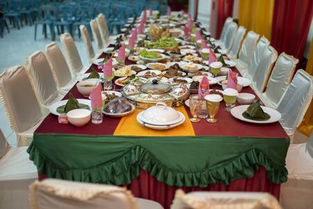 traditional Acehnese menu is served for the bride and her entourage at the wedding reception