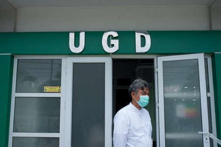 Medical personnel use masks to prevent the transmission of the covid-19 outbreak in front of the emergency room at a puskesmas in Banda Aceh, Aceh province, Indonesia, Monday May 5, 2020.