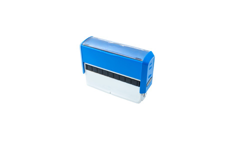 Blue self ink stamping device on white background photo