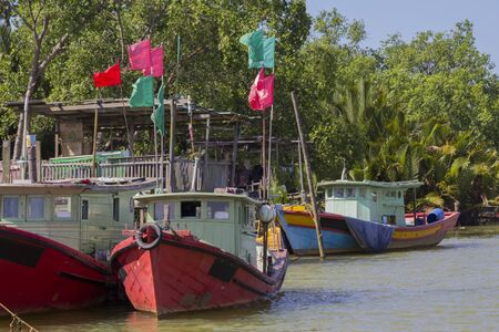 river side: the wooden fisherman boat docked at the river side