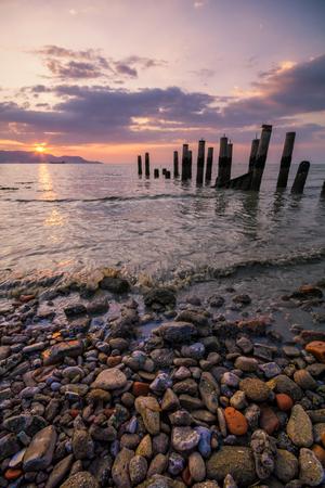pinang: Sunset at Robina Beach, Butterworh Pulau Pinang with the view of abandoned jetty and beautiful rocks and sunset.