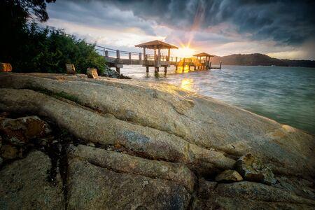 pinang: Jetty Batu Musang, Batu Kawan, Pulau Pinang before the storm with dramatic dark cloud before the rain Stock Photo