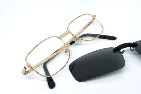 Glasses with clip sunglasses on white background