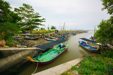 Colorful traditional fisherman boat docked at the tributary side at Yan beach, Kedah, Malaysia. Shoot during hot sunny day