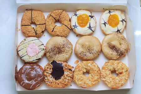 Different type and taste of donuts set in a box