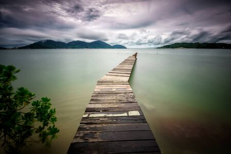 Beautiful golden sunset over the wooden jetty at Marina Island, Lumut Perak Malaysia. Banque d'images