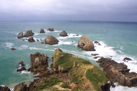 Rock islets of Nugget Points in Catlin, New Zealand South Island Stock Photo