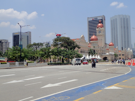 Almost deserted Jalan Raja with the iconic, Moorish style architecture of Sultan Abdul Samad Building and modern skyscrapers in the background near Dataran Merdeka in Kuala Lumpur, Malaysia. Editorial