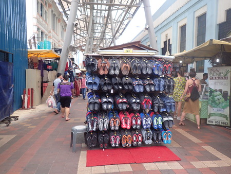 Kuala Lumpur, Malaysia. April 5 2018. Knockoff slippers, sandals and shoes are openly sell at a stall in Kasturi Walk which is a semi covered pedestrianized street of Central Market, Kuala Lumpur. Publikacyjne