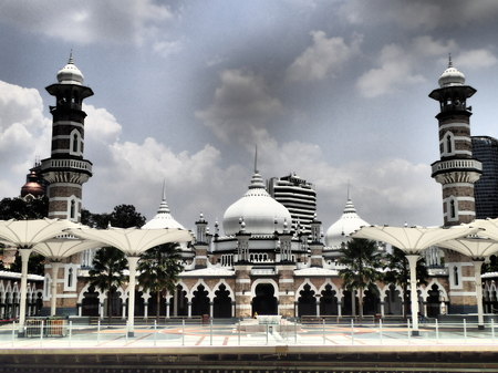 View of the Jamek Mosque or Masjid Jamek from across the Klang River. Officially named as Sultan Abdul Samad Jamek Mosque, it is one of the oldest mosque in Kuala Lumpur built in 1909 with Moorish sty