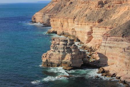 Precarious coastal rock formation called the Rock Island at Kalbarri National Park, Australia.