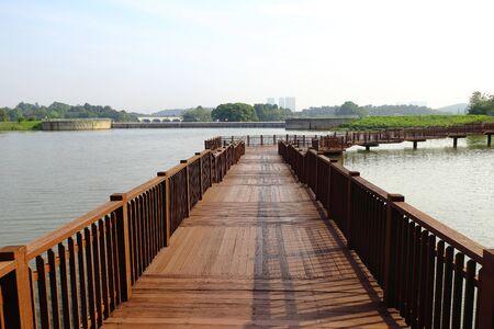 Boardwalk over the lake in Putrajaya Botanical Garden, Malaysia.