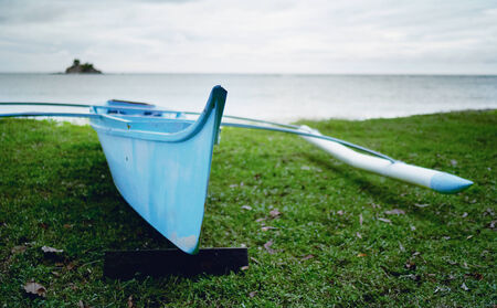 Beautiful blue small blue boat fisherman photo