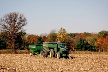 meta: Fall tractor harvesting in field.