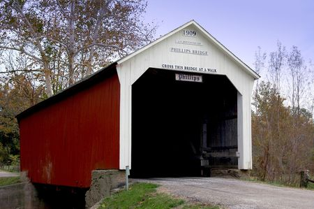 bridge over water: Historic covered bridge over water.
