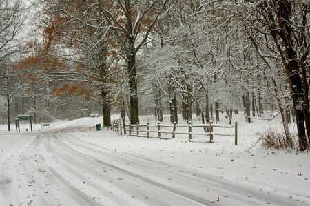 straight path: Fence along the winter road. Stock Photo