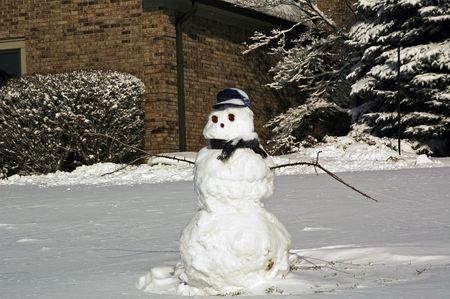 Snowman in yard after a fresh fallen snow.
