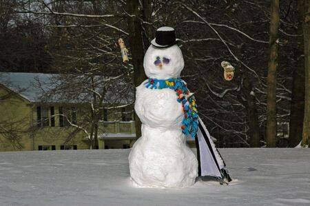 stove pipe: Snowman in winter with stove pipe hat, scarf, and mitts.