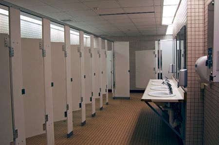 Public womens bathroom stalls. Stock Photo