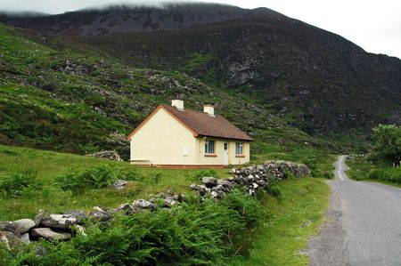 Cottage with quaint stone wall.