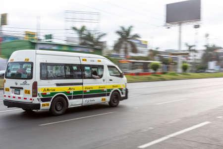 Lima, Peru - April 8 2020: Bus passengers wearing a mask, public transportation in Lima amid a coronavirus outbreak. Éditoriale