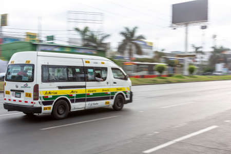 Lima, Peru - April 8 2020: Bus passengers wearing a mask, public transportation in Lima amid a coronavirus outbreak. Sajtókép