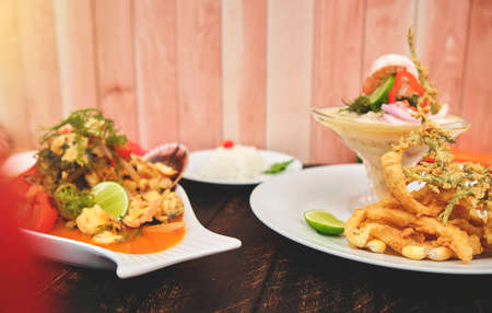 """Peruvian food: called """"Leche de tigre"""" and """"sudado de seafood"""", seafood (fish sweat, scallops, shrimp, octopus, snail, mixed with vegetables and spicy juice) top view. Selective focus Standard-Bild"""