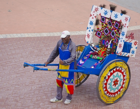 DURBAN, SOUTH AFRICA - MARCH 2013: Happy rickshaw driver poses on March 13, 2013 on Durban