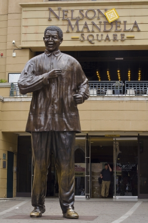 apartheid: JOHANNESBURG - MARCH 10: Bronze statue of Nelson Mandela on March 10, 2013 in Johannesburg. The erection of this statue marked the 10th anniversary of democracy in South Africa.